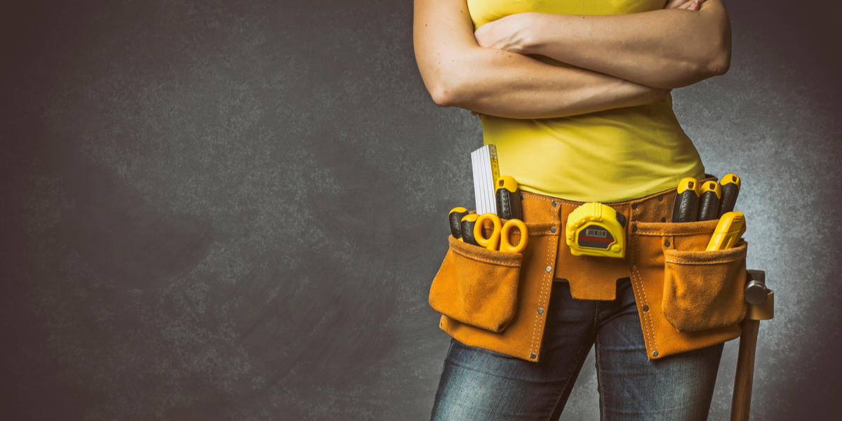 Woman wearing toolbelt.
